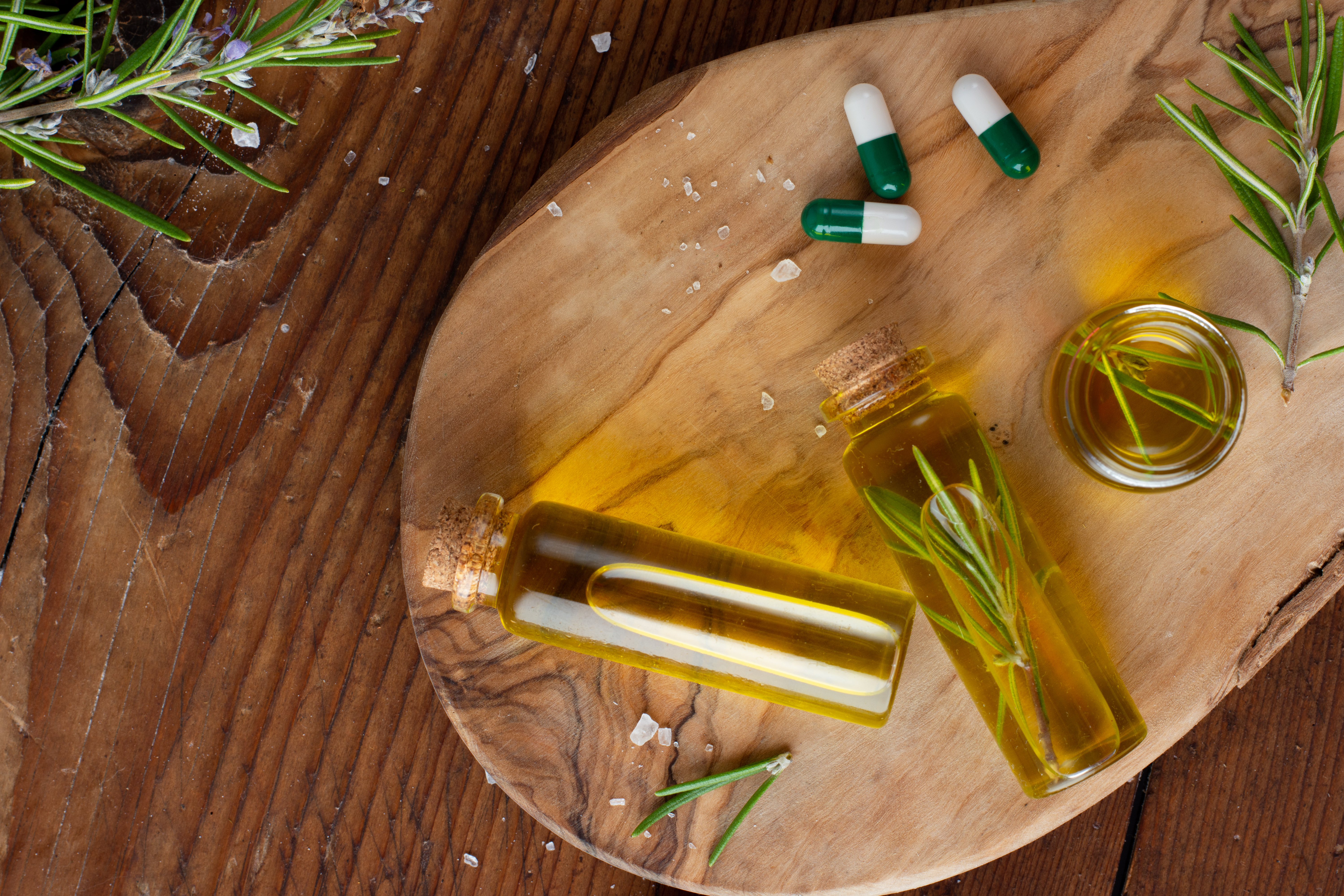 top-view-bottles-with-organic-oil-pills-table