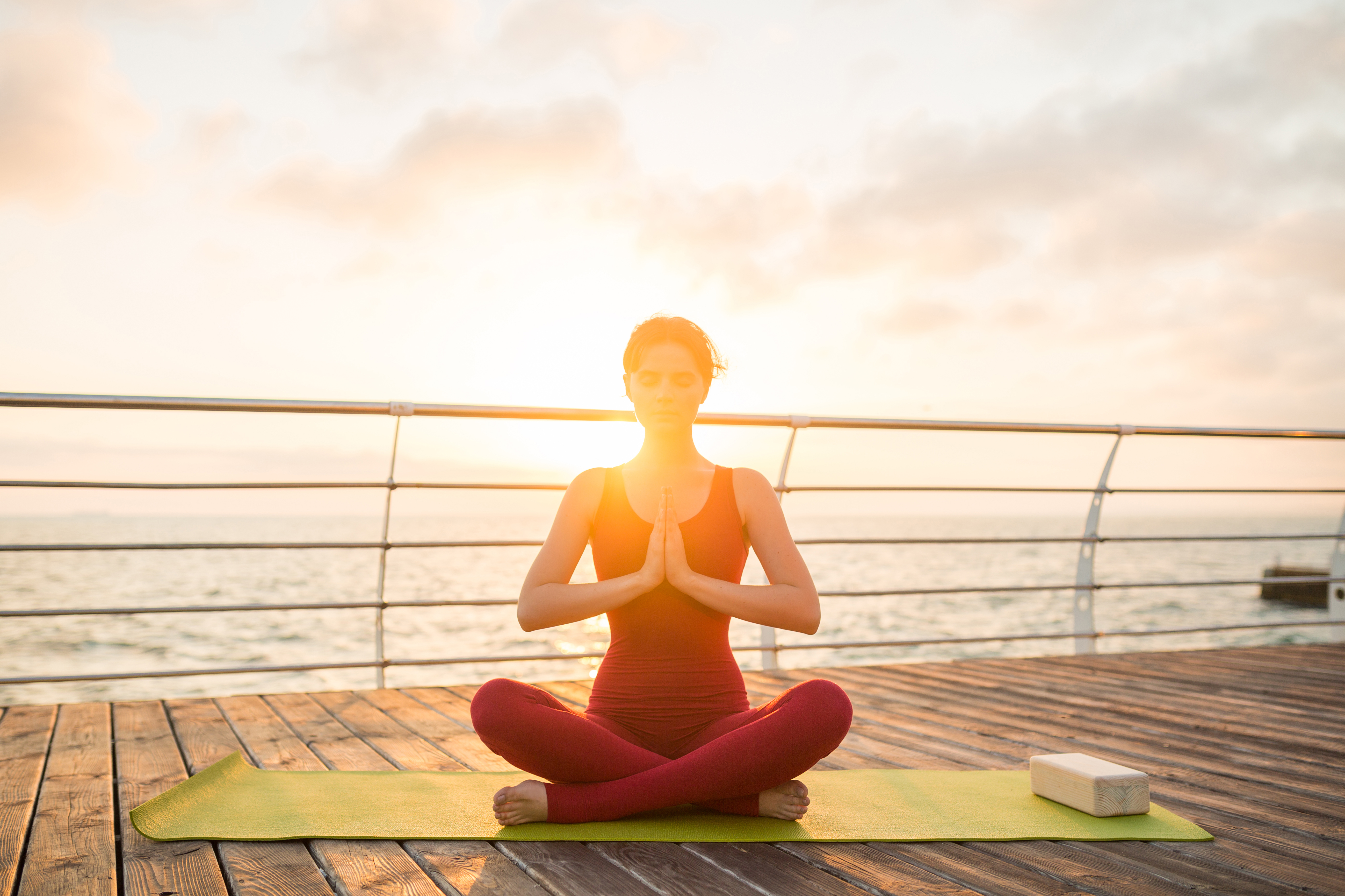 young-slim-beautiful-attractive-woman-doing-yoga-morning-sunrise-by-sea-healthy-lifestyle