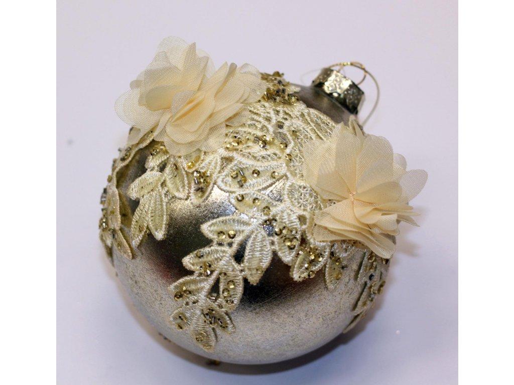 Ozdoba zlatá s květem velká.