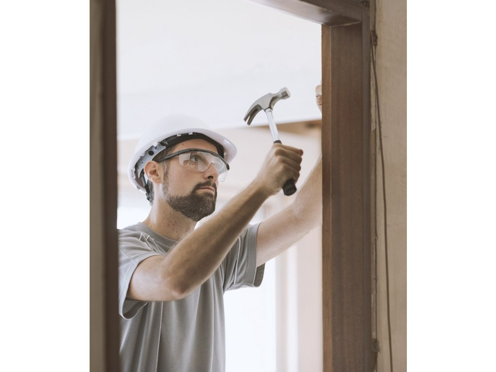 carpenter installing a door jamb at home LFY5VK6