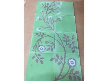 cementova dlazba.malena modry kvet cerny stonek na zelenem podkladu vinci projekt