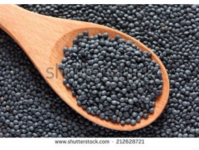 stock photo black beluga lentils in a wooden spoon on black beluga lentils background close up 212628721