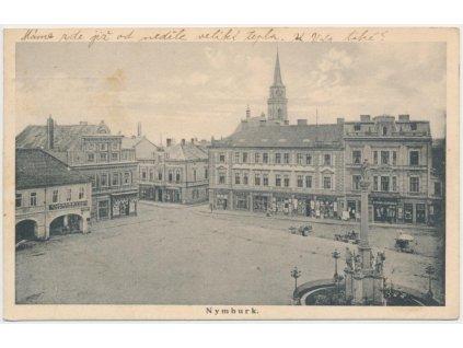 40 - Nymburk, náměstí s kašnou a obchůdky, cukrářství K. Hepner..,1934