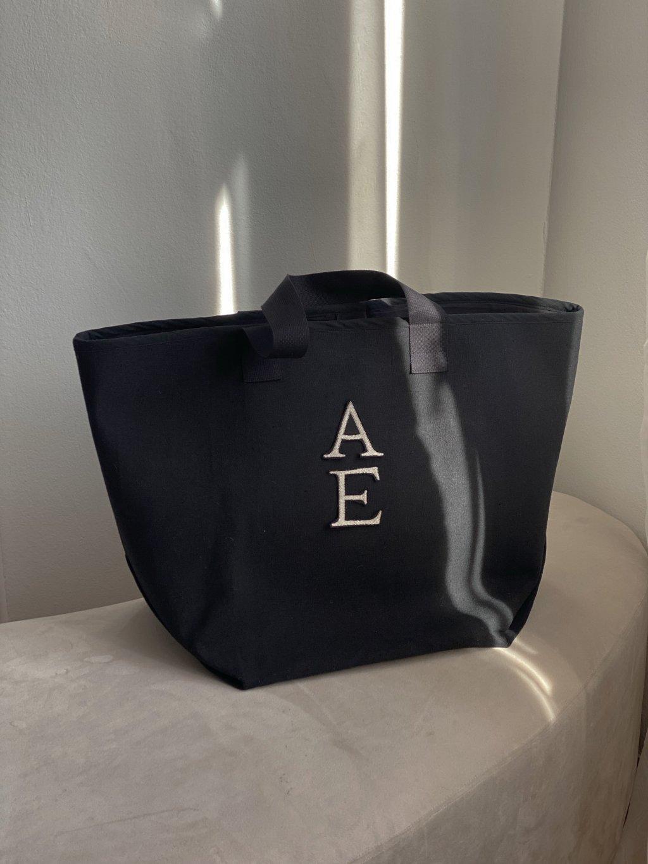 Selema zimní taška z vlny s monogramem.