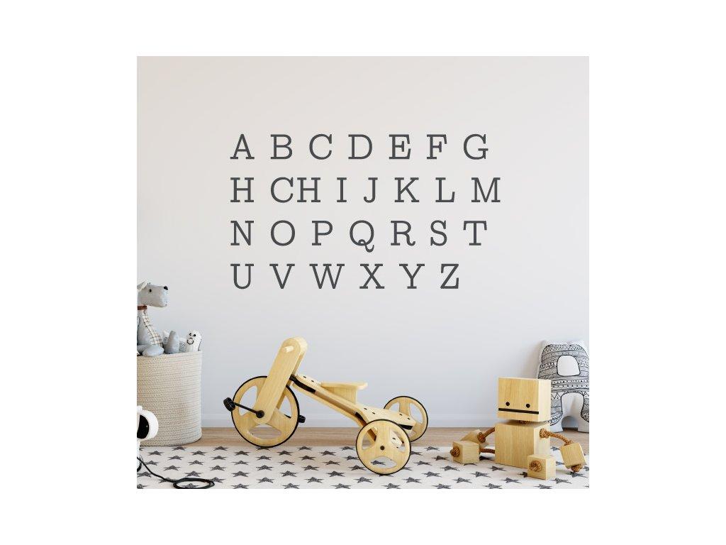 samolepky na stenu pismena abecedy nalepene na zdi v detskem pokojicku barva cerna