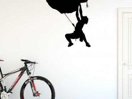 horolezec samolepka na zed na zdi v chodbe s kolem