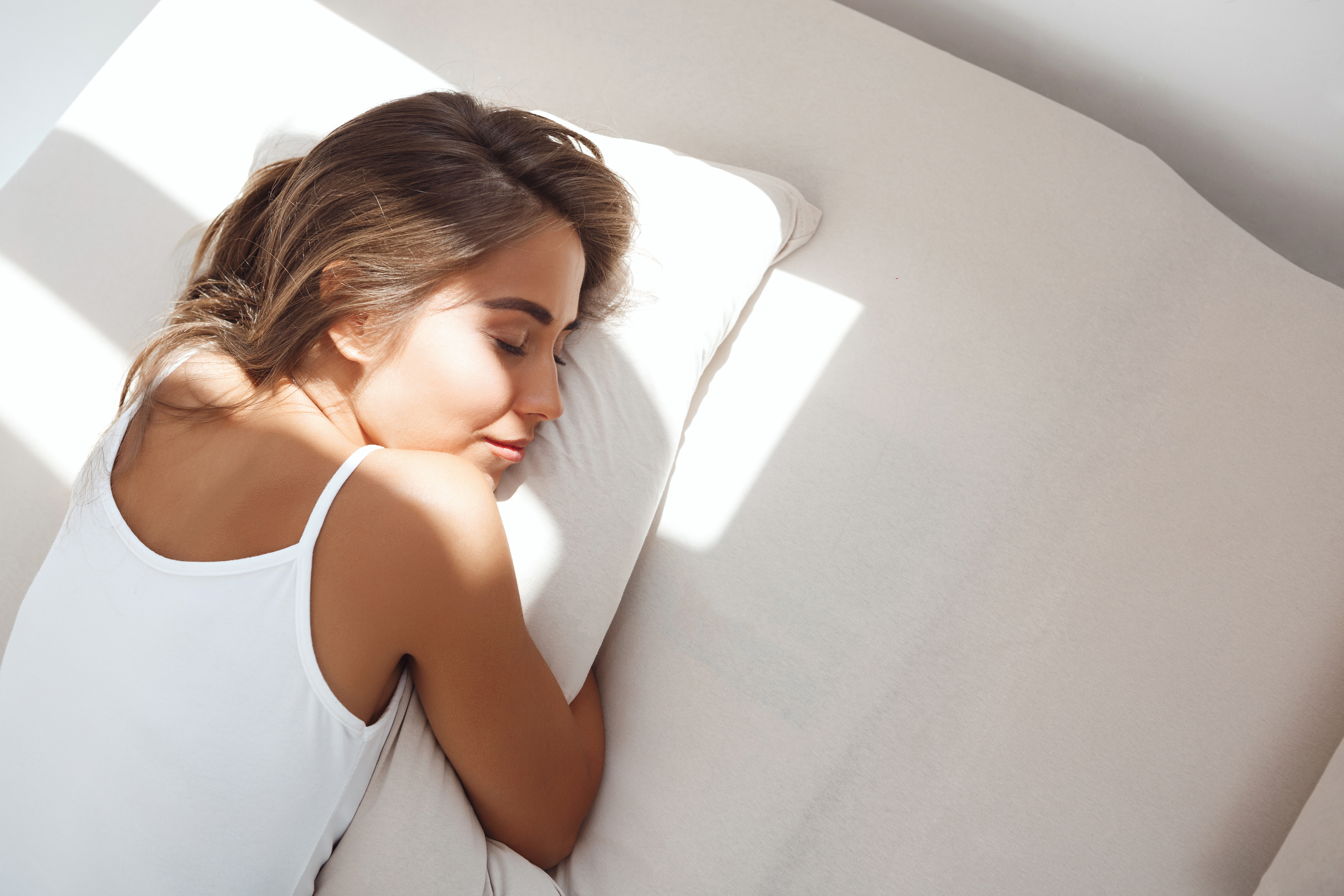 young-beautiful-woman-lying-bed-early-morning