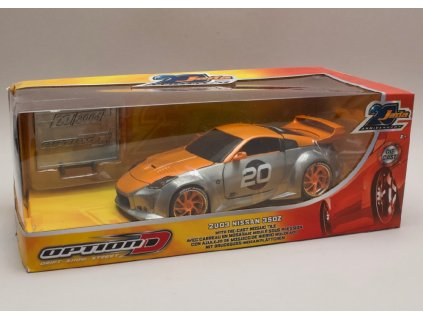 Nissan 350Z 2003 20th anniversary series leštěný kov oranžová 1 24 Jada Toys 45001 02