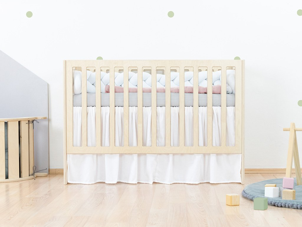 Ruffled bed skirt for a baby cot mattress in the size of 60 cm x 120 cm