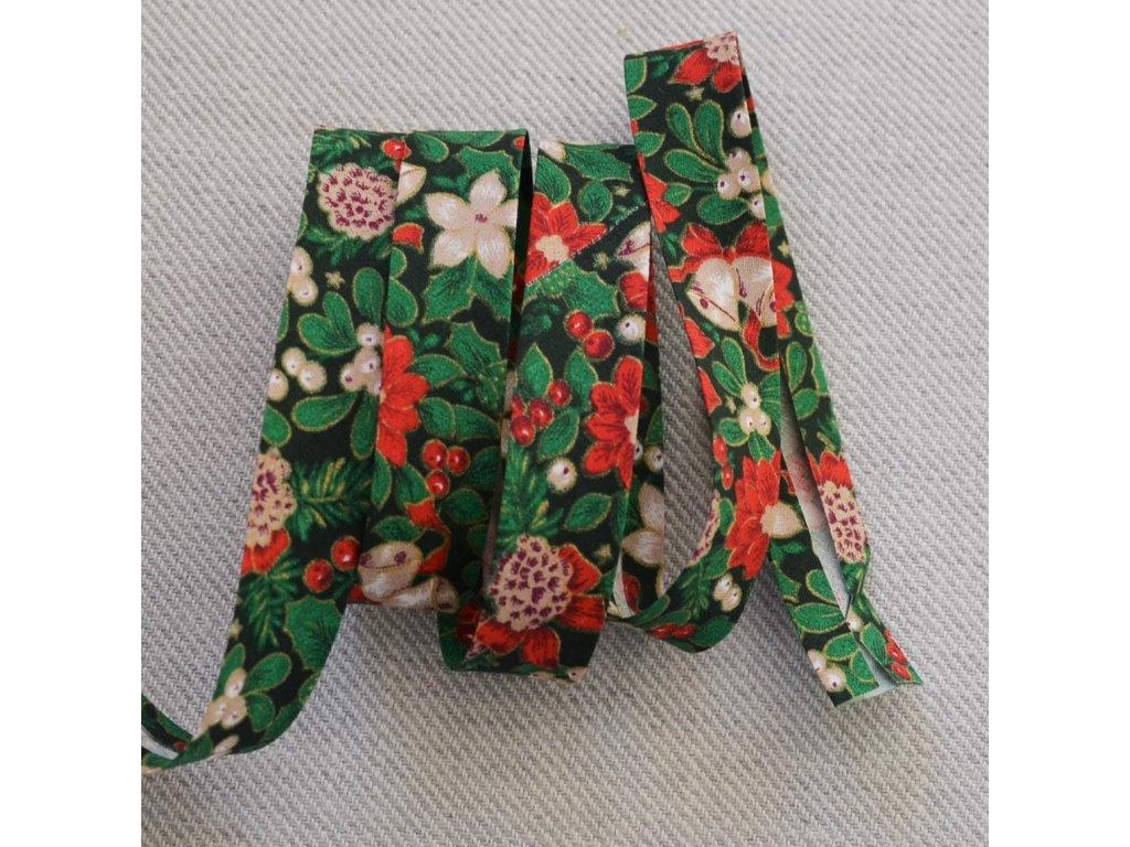 0,5 m šikmý proužek zažehlený vánoční růže na zelené 18 mm (bavlna)