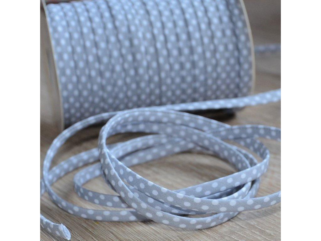 0,5 m šikmý proužek SEŠITÝ (dutinka) šedý s puntíky 7 mm (bavlna/polyester)