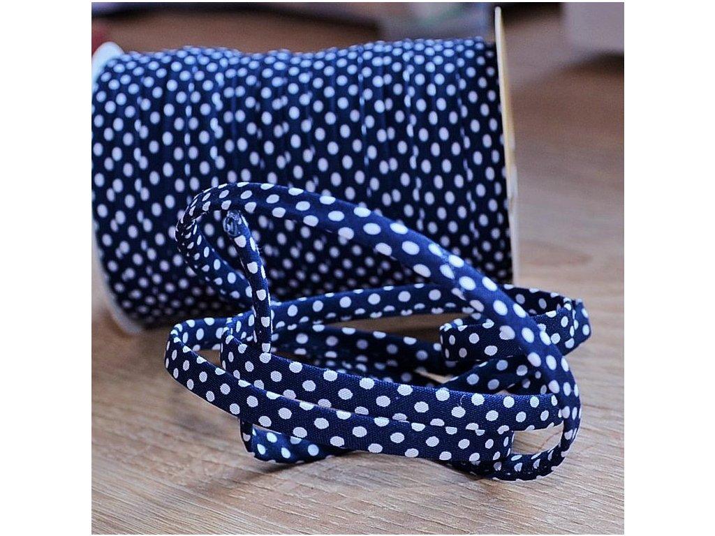 0,5 m šikmý proužek SEŠITÝ (dutinka) tmavě modrý s puntíky 7 mm (bavlna/polyester)