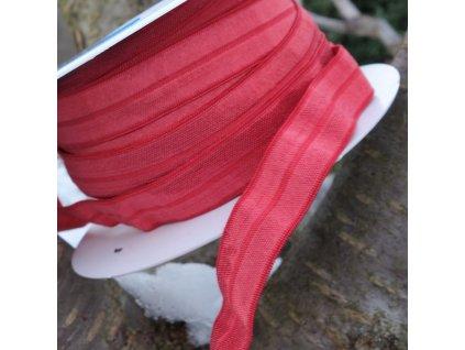 0,5 m půlená lemovací pruženka 15 mm červená s leskem