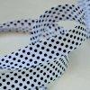 0,5 m šikmý proužek černé puntíky na bílé 18 mm (bavlna/polyester)