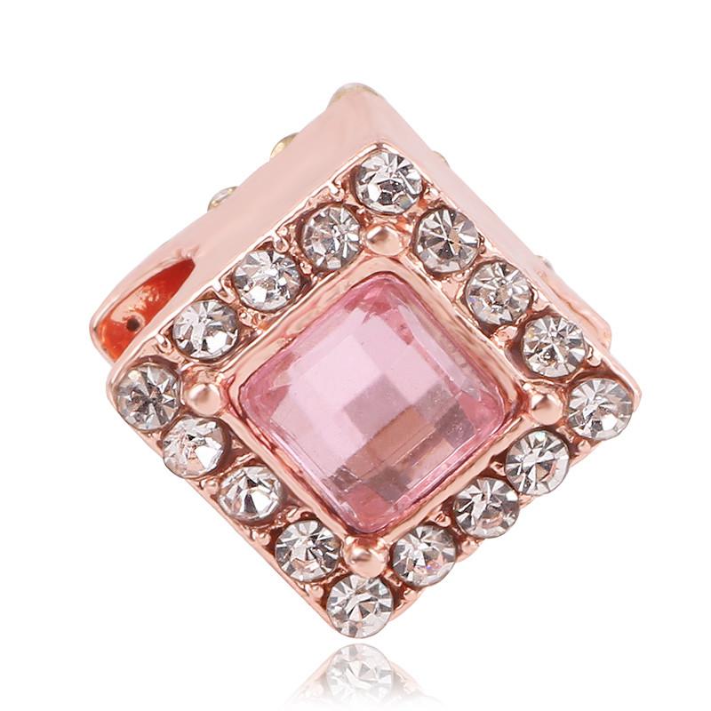 Korálka ružovo - zlatá štýl Pandora v tvare kocky zdobená ružovým kamienkom