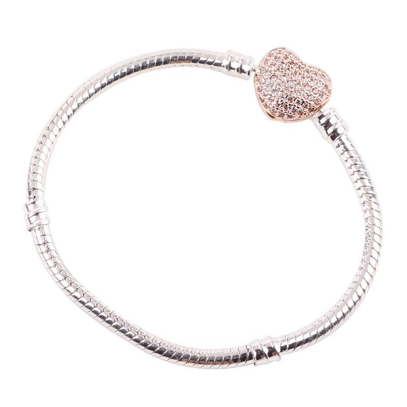 Náramok štýl Pandora jednoduchý so zapínaním v tvare ružovo - zlatého srdca zdobeného zirkónmi