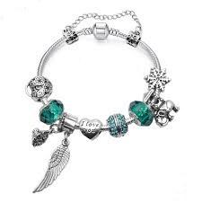 Strieborno - zelený náramok štýl Pandora s  príveskom v tvare krídla