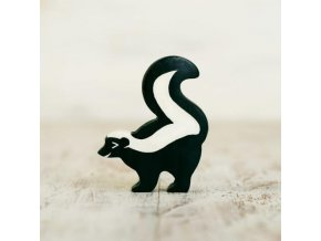 wooden toy skunk figurine