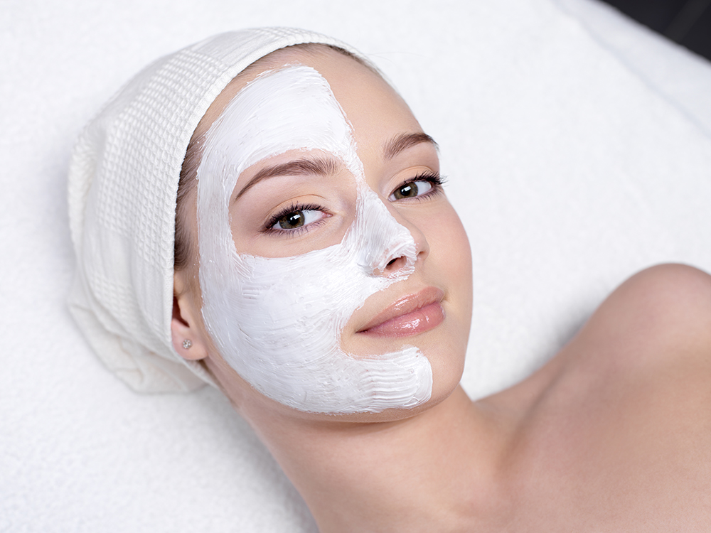 beautiful-young-woman-getting-facial-mask-beauty-salon-indoors