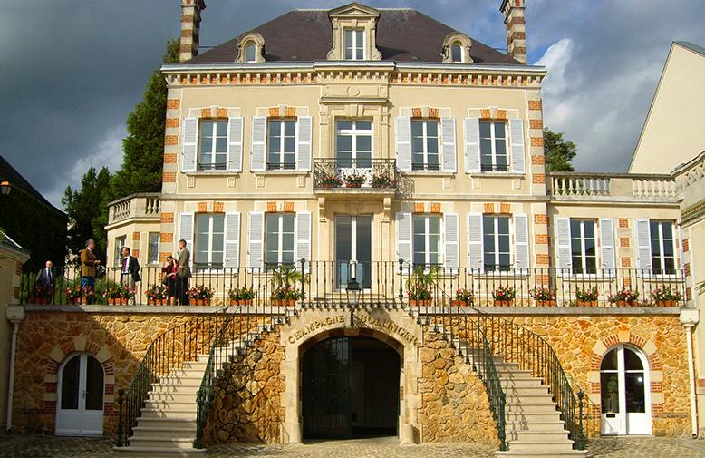 Výrobce šampaňského a šampaňský dům
