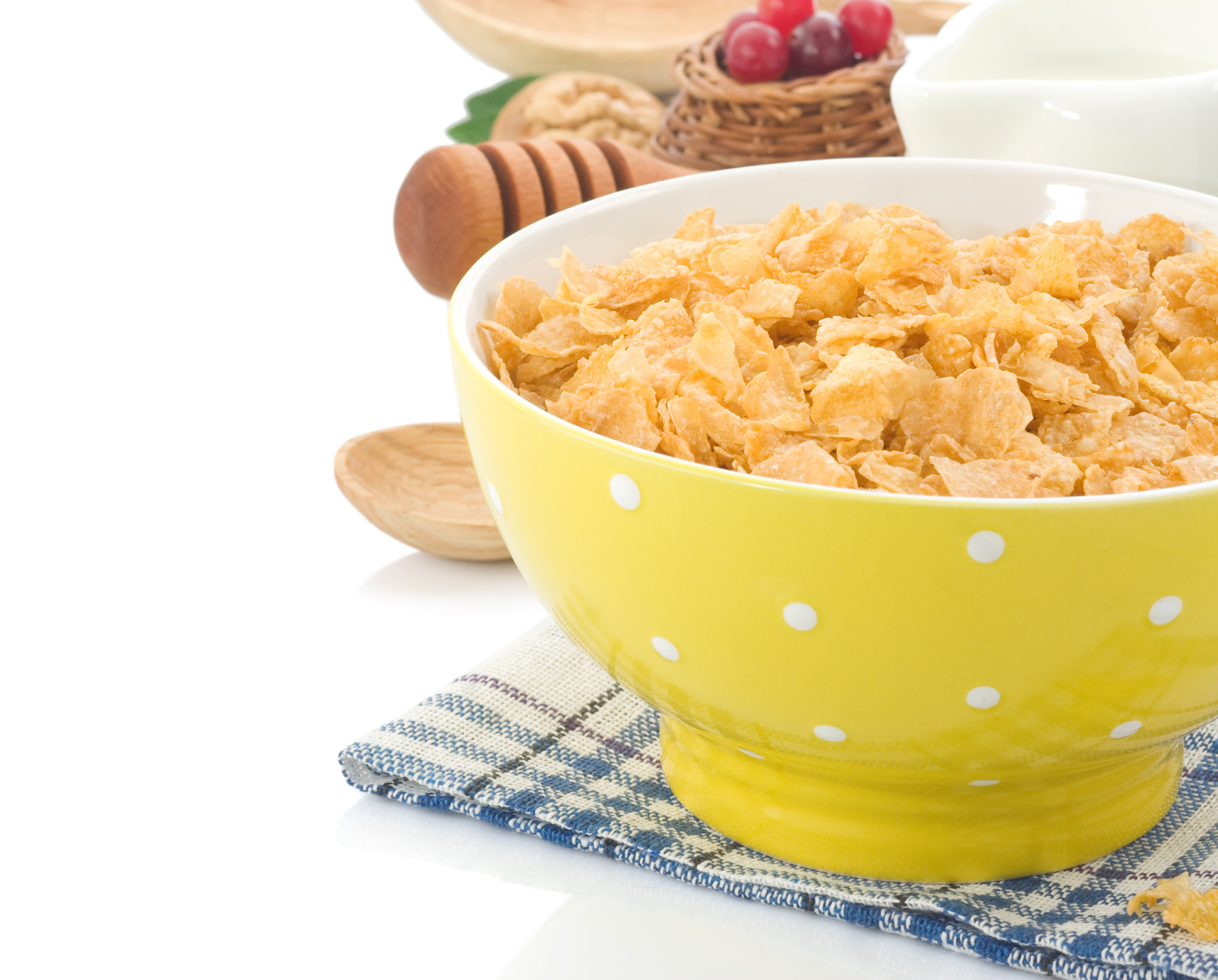 bowl-of-corn-flakes-and-milk-isolated-on-white-PSFHCP7