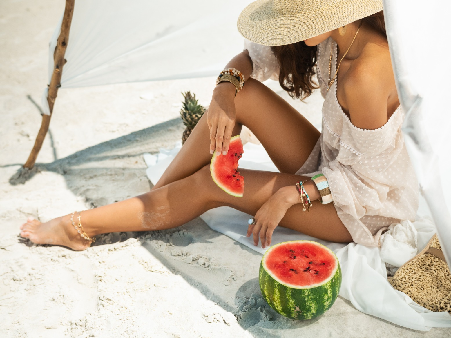 woman-on-the-beach-eating-watermelon-outdoors-UQF5TRT (1) (1) (1)