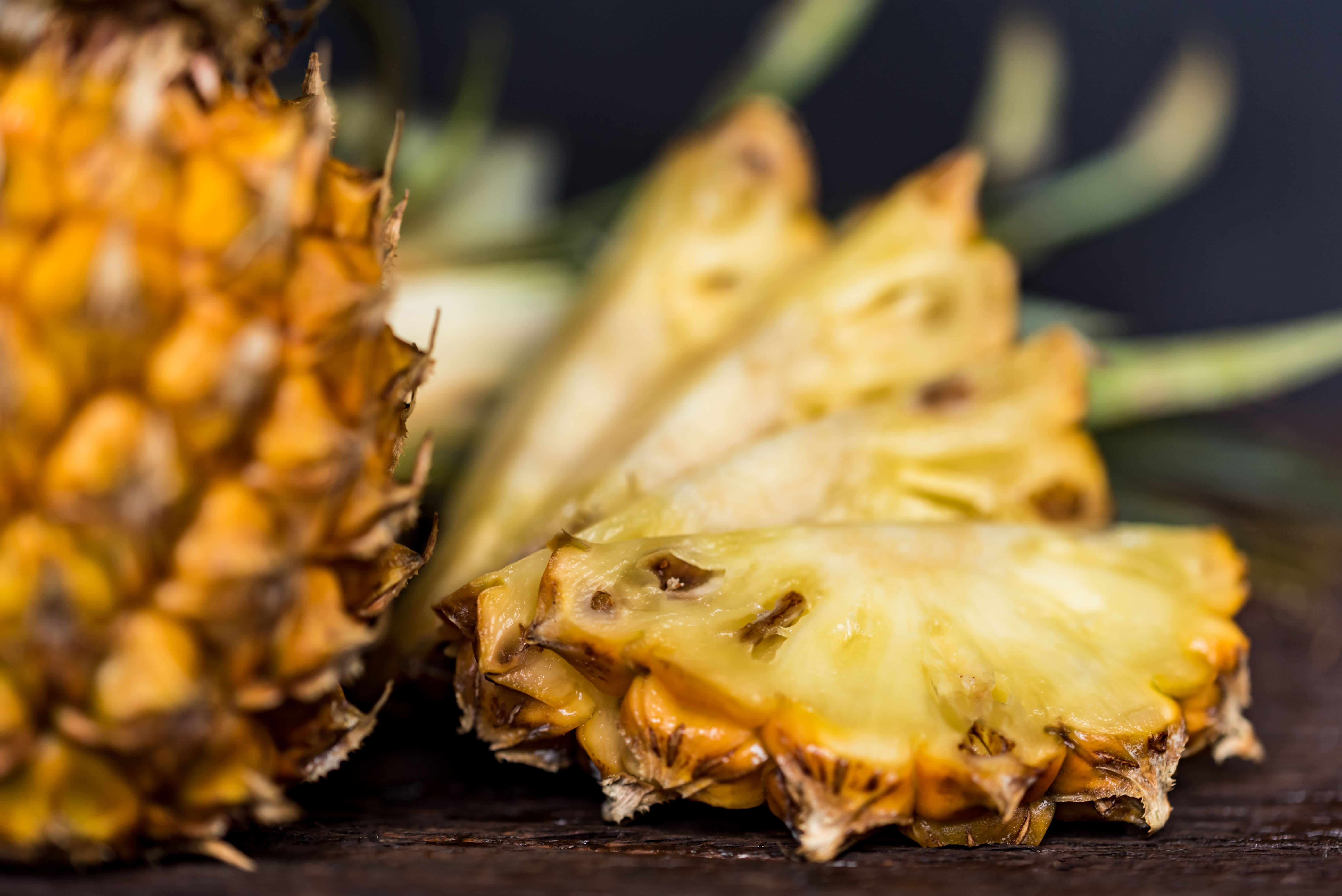 pineapples-on-a-dark-wooden-background-X4FHN6C-min