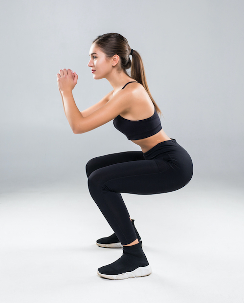 sporty-athletic-woman-squatting-doing-sit-ups-gym-isolated-white-wall