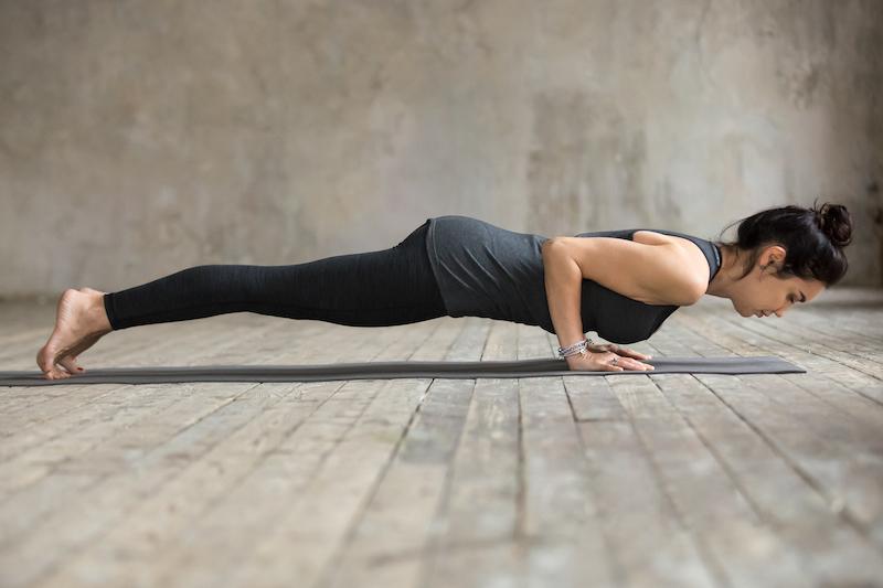young-woman-doing-push-ups-press-ups