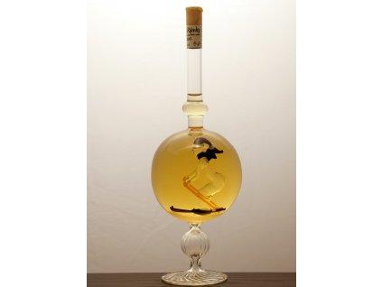 Ozdobná fľaša guľa v nej figúra - lyžiar