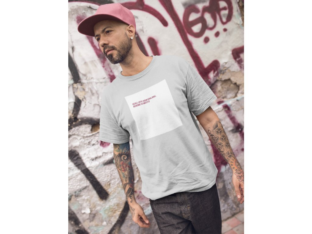 3596 tattooed man walking while wearing a t shirt mockup in an urban area a16983