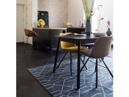 Žlutá čalouněná jídelní židle ZUIVER BRENT s černě lakovou kuželovitou podnoží