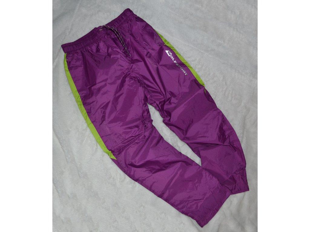 Šusťákové kalhoty zn. WOLF, vel. 158