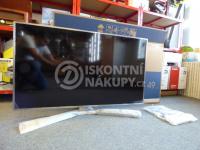 rozbalená televize s poškozeným obalem