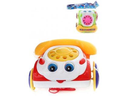 Baby telefon veselý tahací pískací 19cm pohybuje očima 2 barvy plast