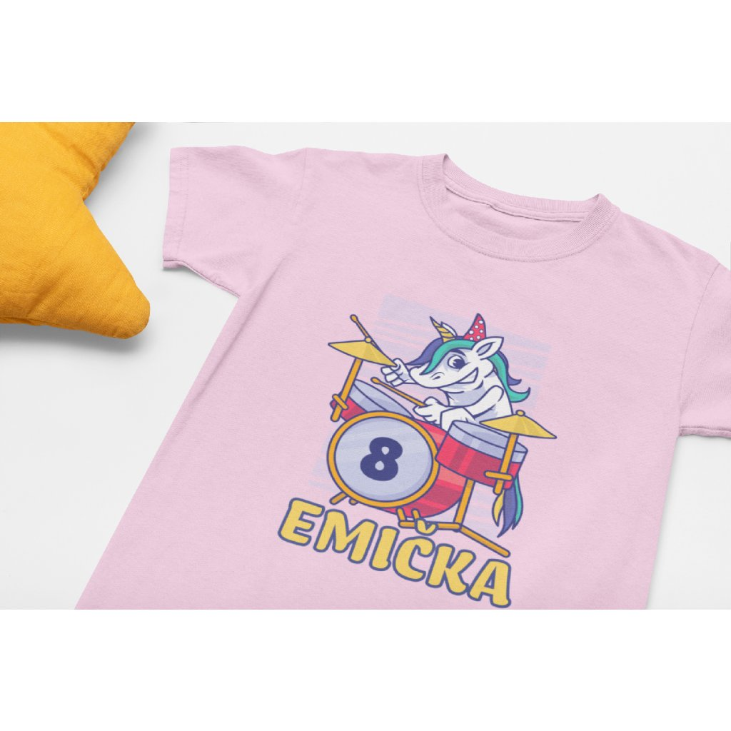 mockup of a flat laid kids t shirt placed next to a star shaped pillow 33945