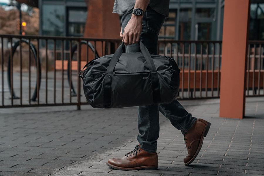 Matador skladacia cestovná taška on grid v ruke 2
