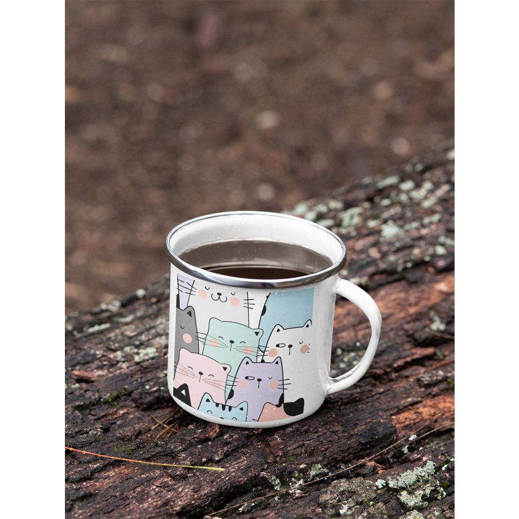 mockup of a 12 oz enamel mug with a silver rim placed on a fallen tree 30820 (4)