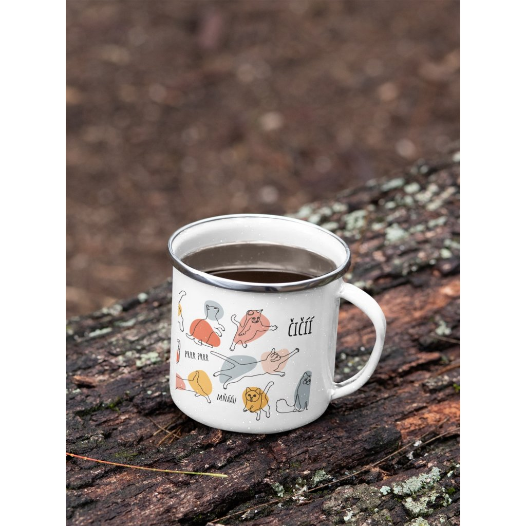 mockup of a 12 oz enamel mug with a silver rim placed on a fallen tree 30820 (12)
