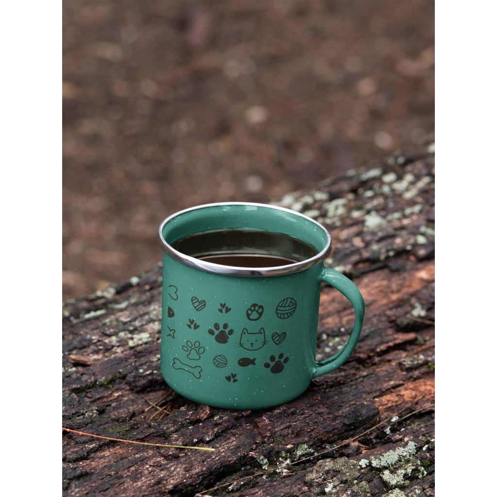 mockup of a 12 oz enamel mug with a silver rim placed on a fallen tree 30820 (6)