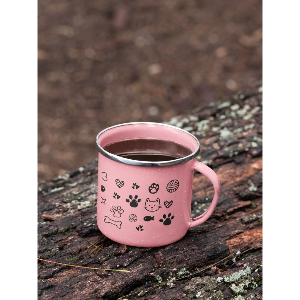 mockup of a 12 oz enamel mug with a silver rim placed on a fallen tree 30820 (5)