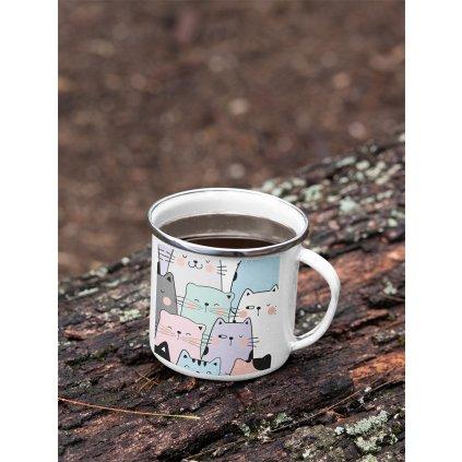 mockup of a 12 oz enamel mug with a silver rim placed on a fallen tree 30820 (4)