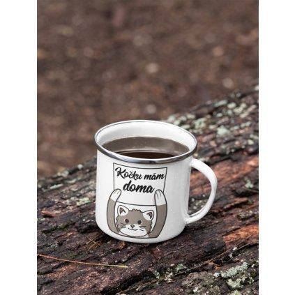 mockup of a 12 oz enamel mug with a silver rim placed on a fallen tree 30820 (13)