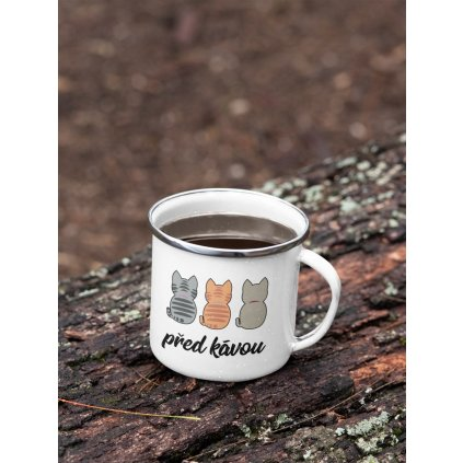 mockup of a 12 oz enamel mug with a silver rim placed on a fallen tree 30820 (10)