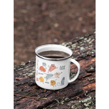 mockup of a 12 oz enamel mug with a silver rim placed on a fallen tree 30820 (12)
