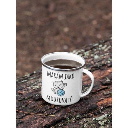 mockup of a 12 oz enamel mug with a silver rim placed on a fallen tree 30820 (8)