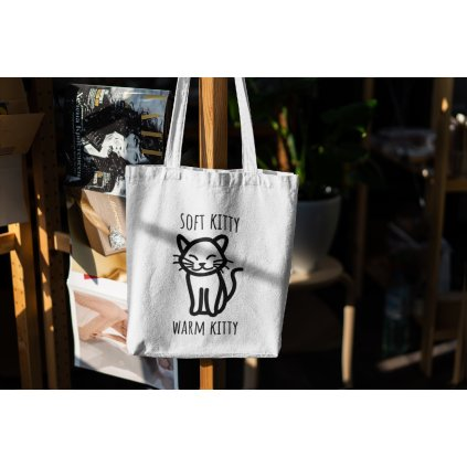 mockup of a canvas bag hanging from a wooden rack 3150 el1