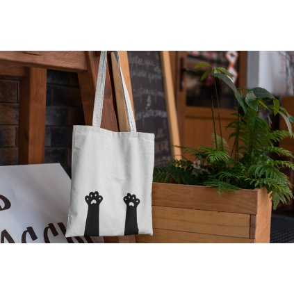 mockup of a tote bag hanging from a piece of furniture 3138 el1