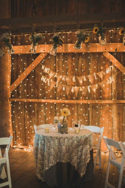 Vintage Wedding Idea Fresh sunflowers paired with twinkle light