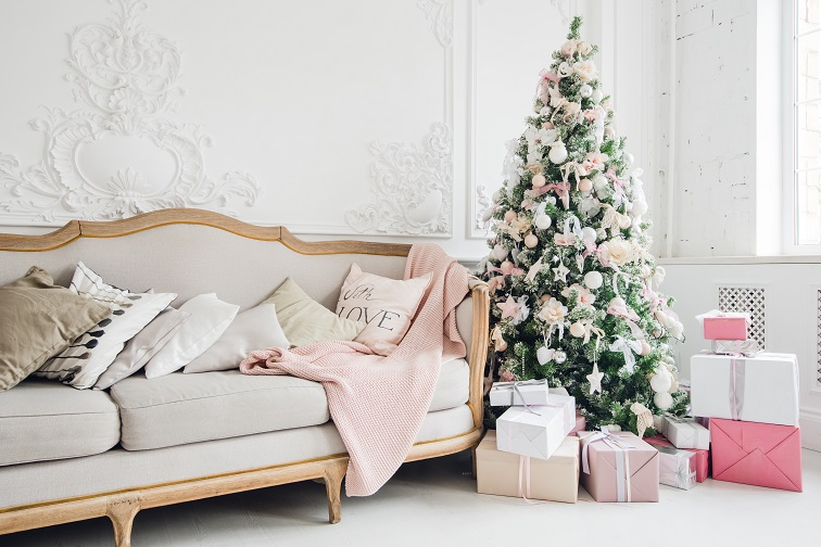 christmas-tree-with-a-white-sofa-in-a-white-room-PUS3FNJ